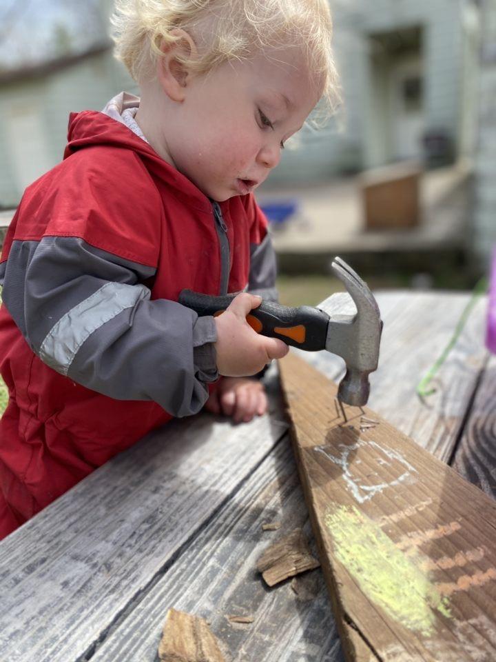child hammering aishling forest school
